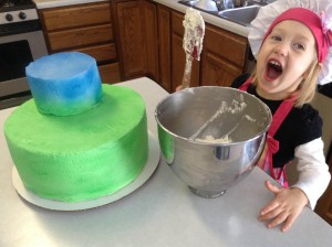 Alyssa, age 2, helps her mom bake a cake.