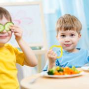 kids eating healthy food in kindergarten or at home